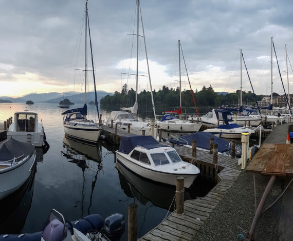 Bowness-On-Windermere, England - September 13, 2016: Panoramic view of Moored Yachts as the Sun Sets over Lake WIndermere